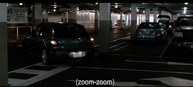 "A screenshot from Knowing (2008) showing a parody caption: ""zoom-zoom"""