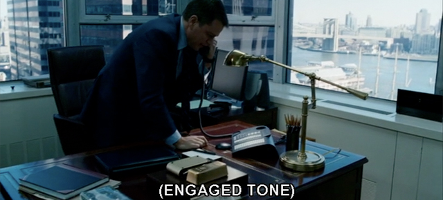 "A screenshot from The Adjustment Bureau featuring Matt Damon on the phone with a caption displaying ""engaged tone"""